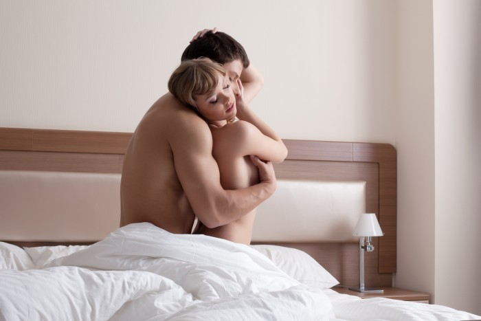 Young beauty Couple making morning sex in bedroom