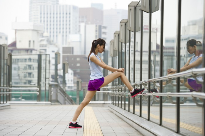 Female exercising in an urban environment