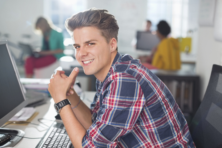 Businessman smiling at desk