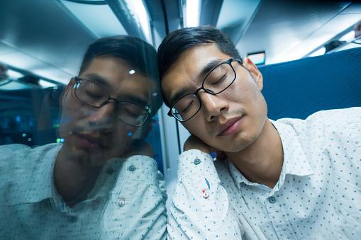 Man sleep on train at night