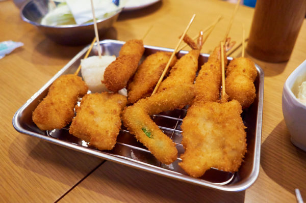 High Angle View Of Kushikatsu In Tray On Wooden Table