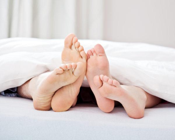 Loving couple feet
