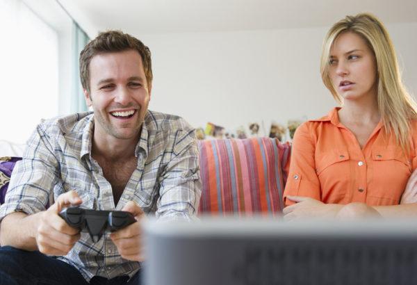 Girlfriend mat at boyfriend playing video game