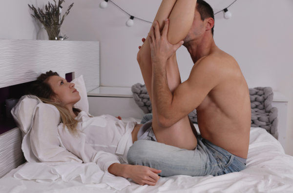 Sensual Couple kissing in bed. Love, Passion, Relationship, Tenderness concept
