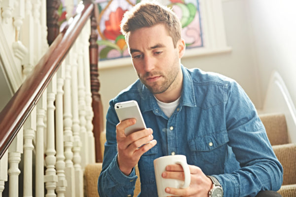 Man using smartphone on stairs