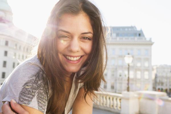 Confident woman smiling.