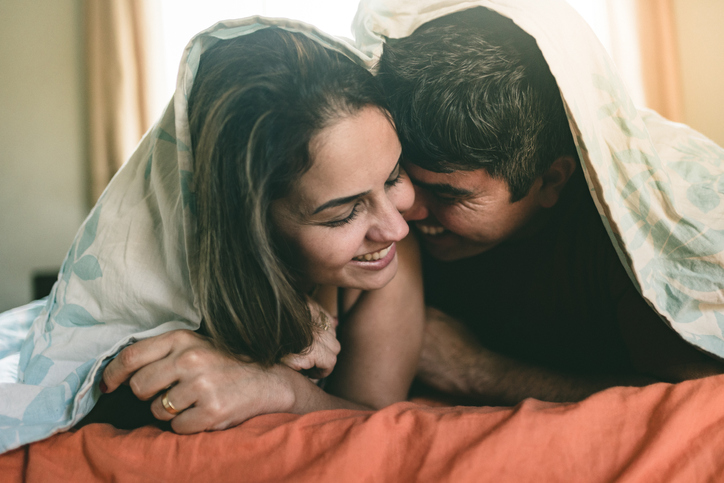 Couple in bed in the morning