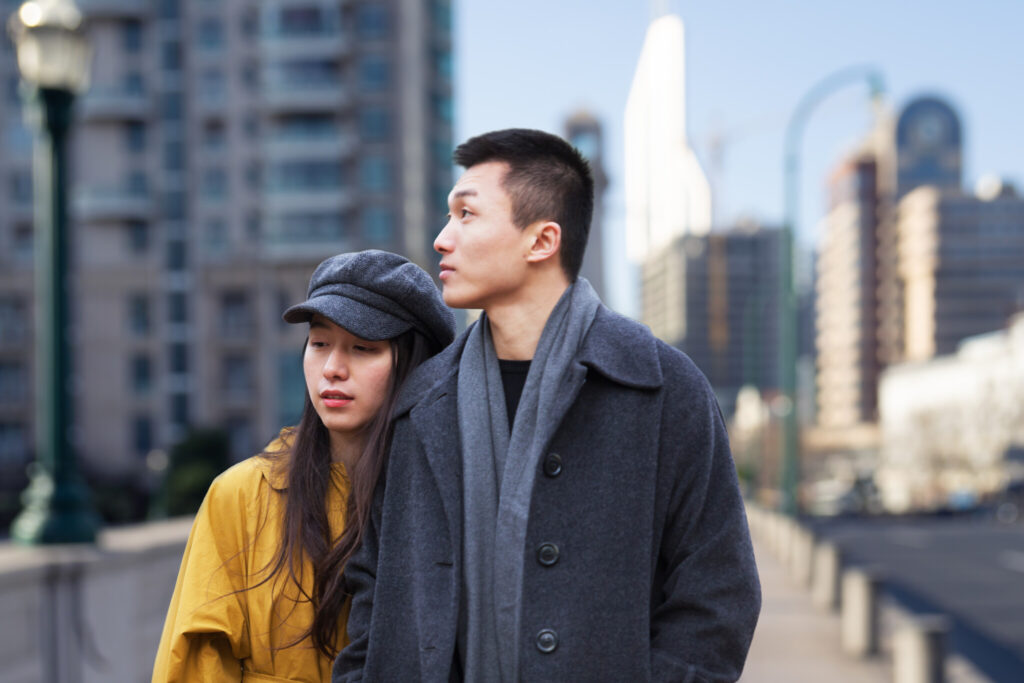 A young couple walks through the streets of Shanghai,China – East Asia,