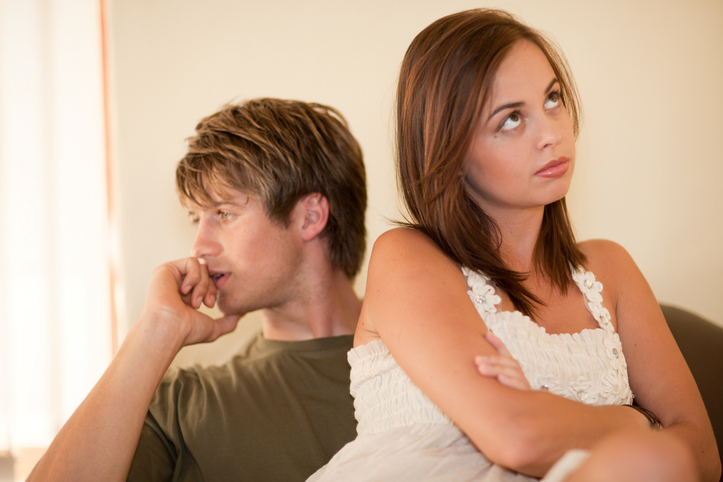 Couple arguing on sofa