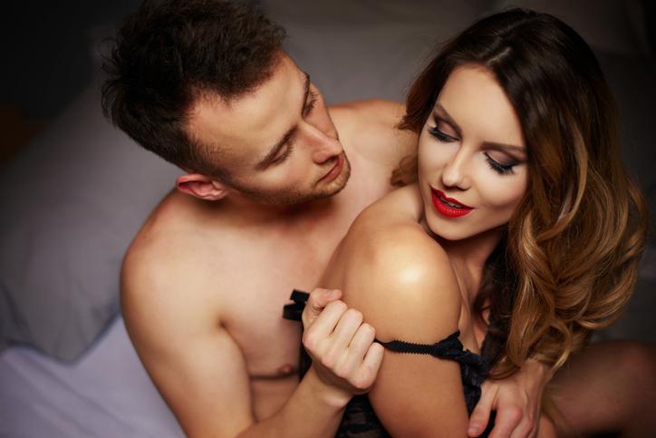 Man taking off bra from his girlfriend. Debica, Poland