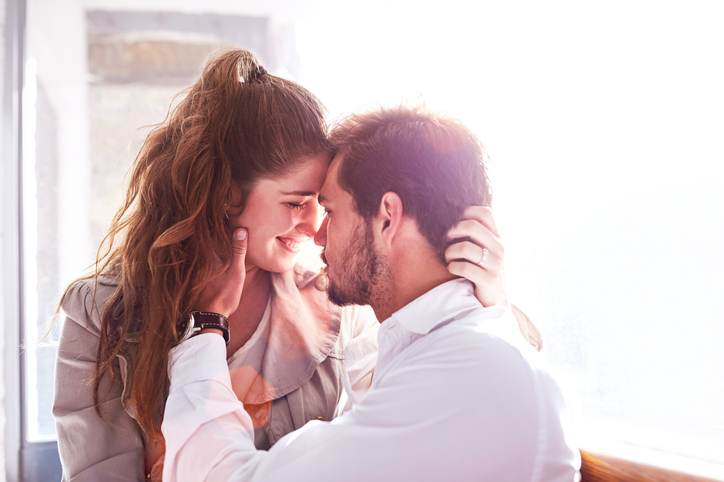 Romantic young couple face to face in office