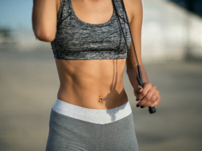 Close up of sporty woman abdominal muscles